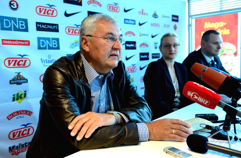 Jonas Kazlauskas (L), head coach of the national basketball team of Lithuania, speaks during a news conference in Vilnius, Lithuania, July 1, 2014. Jonas Kazlauskas .