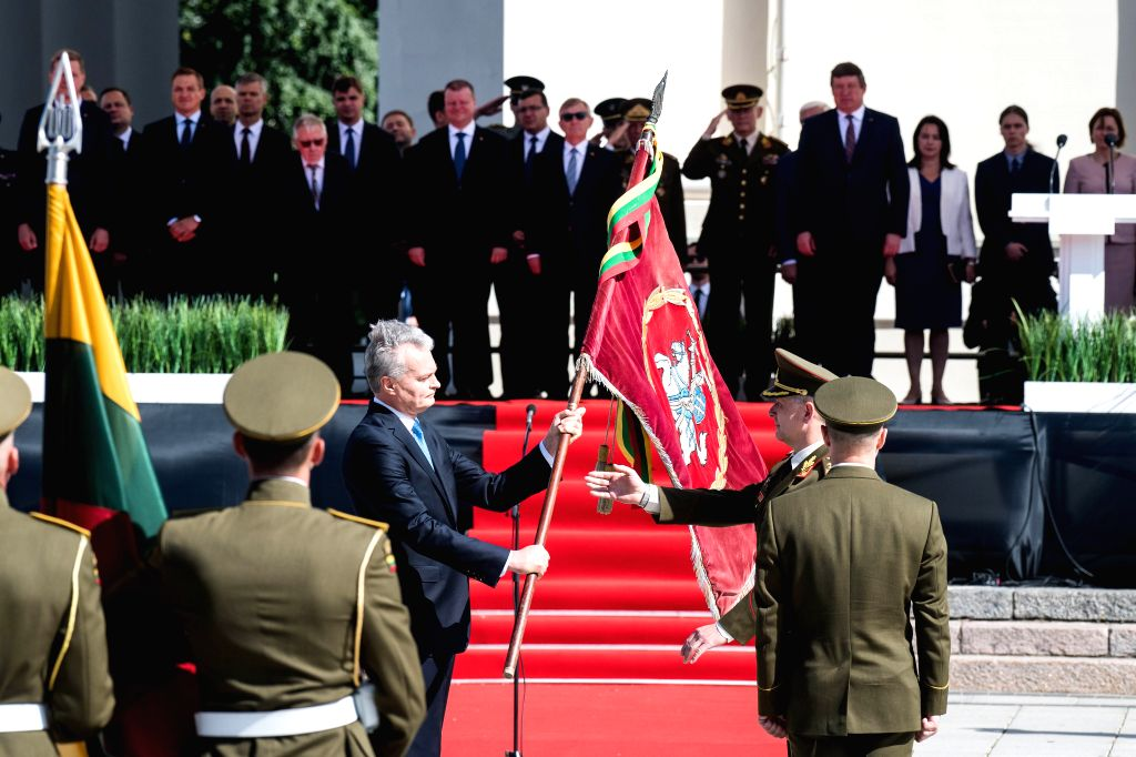 VILNIUS, July 26, 2019 - Lithuanian President Gitanas Nauseda (L) passes on the flag of the Armed Forces to the new Chief of Defense Major General Valdemaras Rupsys during an inauguration ceremony in ...