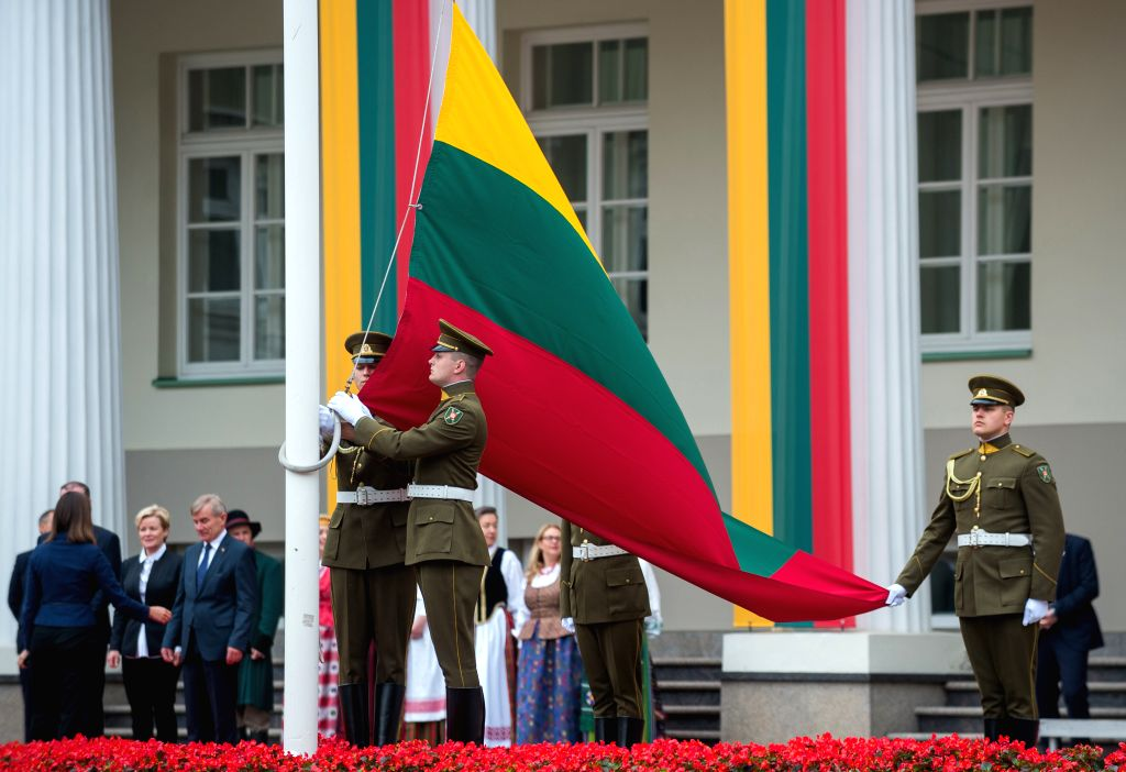 VILNIUS, July 6, 2017 - Lithuanian honor guards raise the national flag during the celebration of Statehood Day in Vilnius, Lithuania, July 6, 2017. The Statehood Day is an annual public holiday in ...