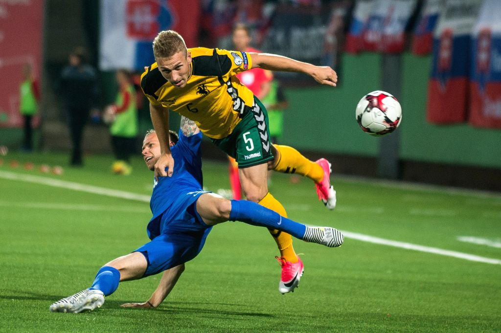 VILNIUS, June 11, 2017 - Vaidas Slavickas (Top) of Lithuania competes during the FIFA World Cup European Qualifying Group F match between Lithuania and Slovakia at LFF Stadium in Vilnius, Lithuania ...
