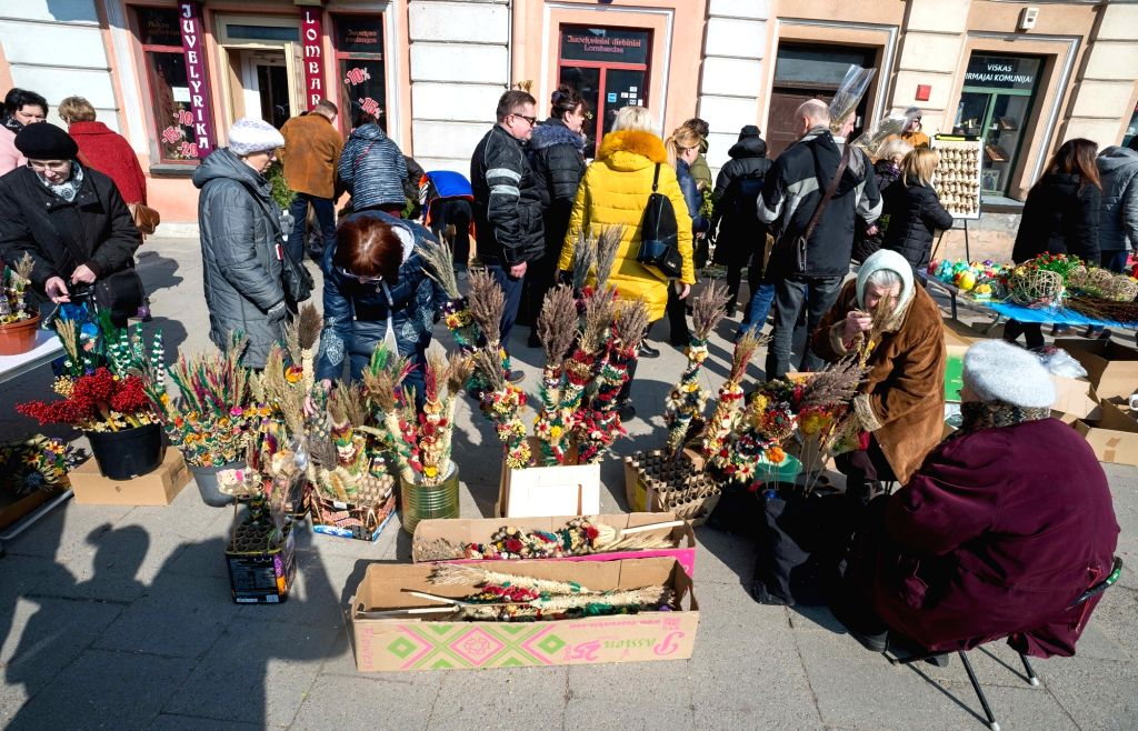 VILNIUS, March 25, 2018 - People buy palm products to celebrate the Palm Sunday in Vilnius, Lithuania, on March 25, 2018. Palm Sunday is a Christian feast that falls on the Sunday before Easter and ...