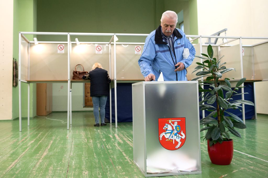 VILNIUS, May 12, 2019 - A man casts his vote at a polling station in Vilnius, Lithuania, on May 12, 2019. The presidential election and two referendums kicked off in Lithuania Sunday with nine ... - Saulius Skvernelis