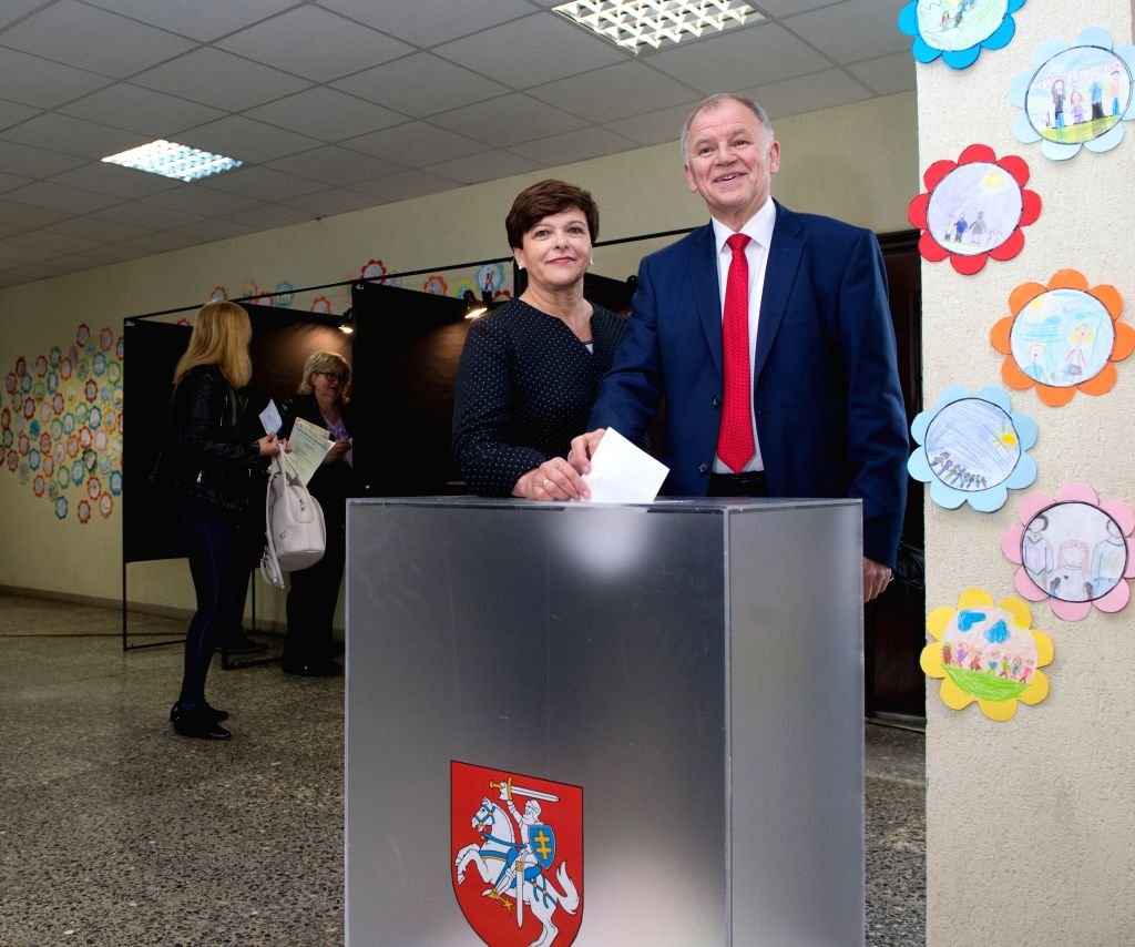 VILNIUS, May 12, 2019 - Lithuania's European Commissioner for Health and Food Safety and presidential candidate Vytenis Povilas Andriukaitis (R) casts his vote at a polling station in Vilnius, ... - Saulius Skvernelis