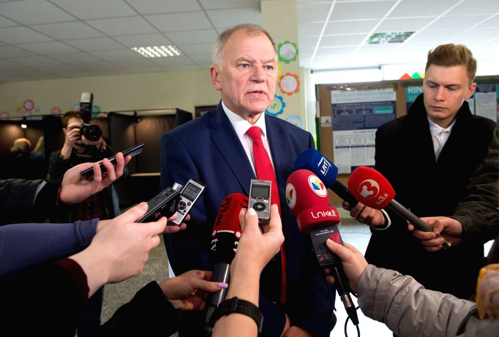 VILNIUS, May 12, 2019 - Lithuania's European Commissioner for Health and Food Safety and presidential candidate Vytenis Povilas Andriukaitis (C) speaks to media after casting his vote at a polling ... - Saulius Skvernelis