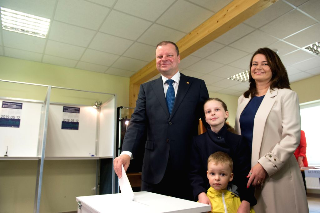 VILNIUS, May 12, 2019 - Lithuania's incumbent Prime Minister and presidential candidate Saulius Skvernelis (L) casts his vote with family at a polling station in Vilnius, Lithuania, on May 12, 2019. ... - Saulius Skvernelis