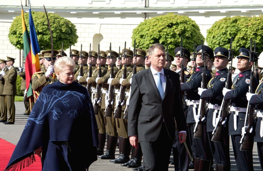 VILNIUS, May 18, 2016 - Lithuanian President Dalia Grybauskaite (L) and Romanian President Klaus Iohannis review the guard of honor in Vilnius, Lithuania, May 18, 2016. Lithuanian President Dalia ...