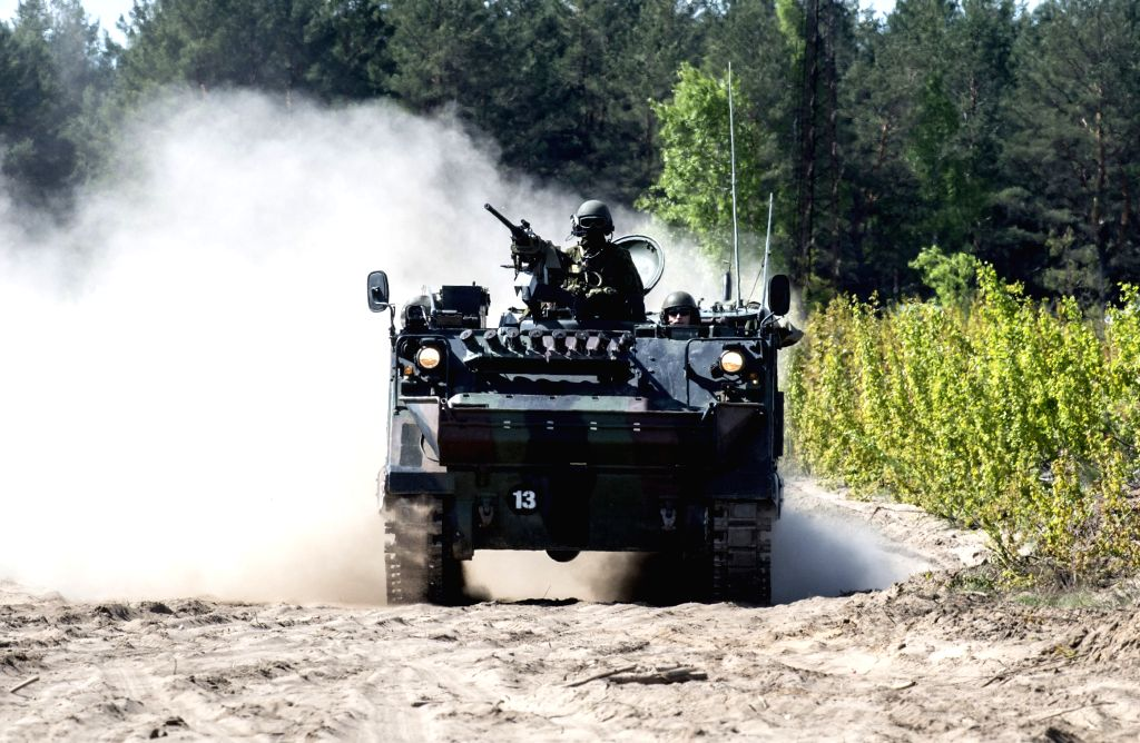 """VILNIUS, May 20, 2016 - A military vehicle attends the media day training of multinational anti-tank exercise """"Hunter 2016"""" in Pabrade, Lithuania, on May 19, 2016. Multinational anti-tank ..."""
