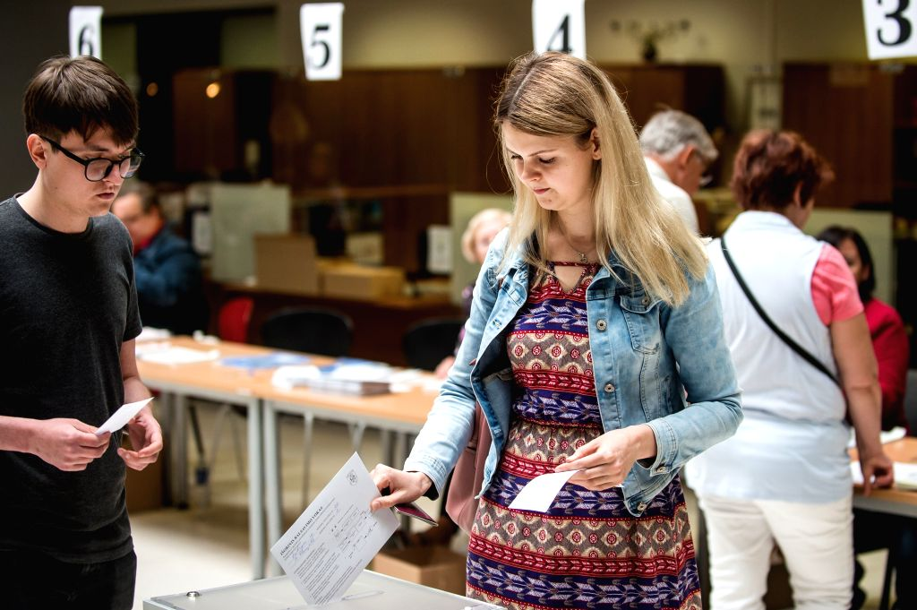 VILNIUS, May 24, 2019 - A woman casts her vote in Vilnius, Lithuania, May 24, 2019. Advance voting in the Lithuanian presidential runoff and the European Parliament election was held from Monday to ...