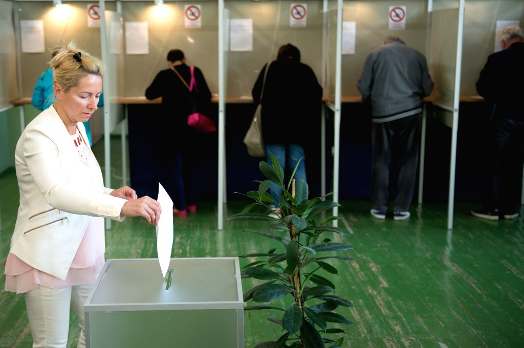 VILNIUS, May 26, 2019 - A woman votes at a polling station in Vilnius, Lithuania, May 26, 2019. The presidential runoff kicked off in Lithuania on Sunday with former Finance Minister Ingrida Simonyte ... - Ingrida Simonyte