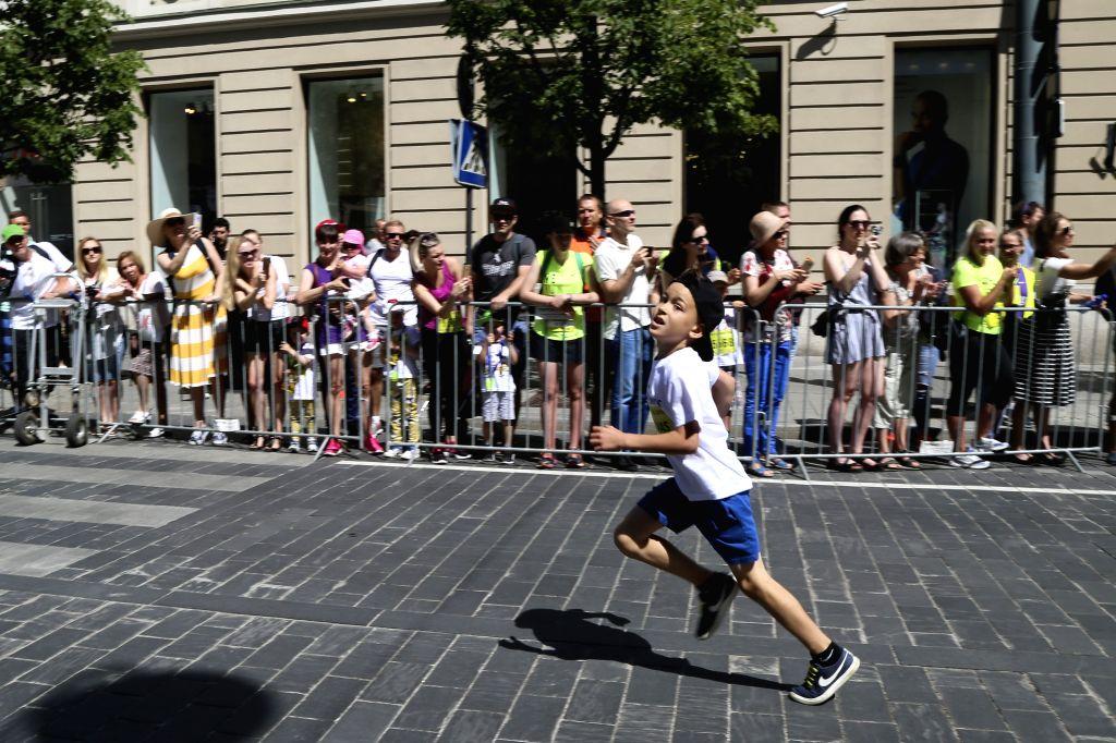 "VILNIUS, May 27, 2018 - A kid runs during the ""We Run Vilnius 2018"" activity in Vilnius, Lithuania, May 27, 2018."