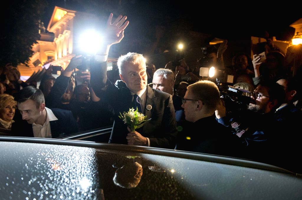 VILNIUS, May 27, 2019 - Gitanas Nauseda (C) waves to the supporters in Vilnius, Lithuania, May 26, 2019. Gitanas Nauseda won Lithuania's presidential election, garnering almost 69 percent of the vote ...