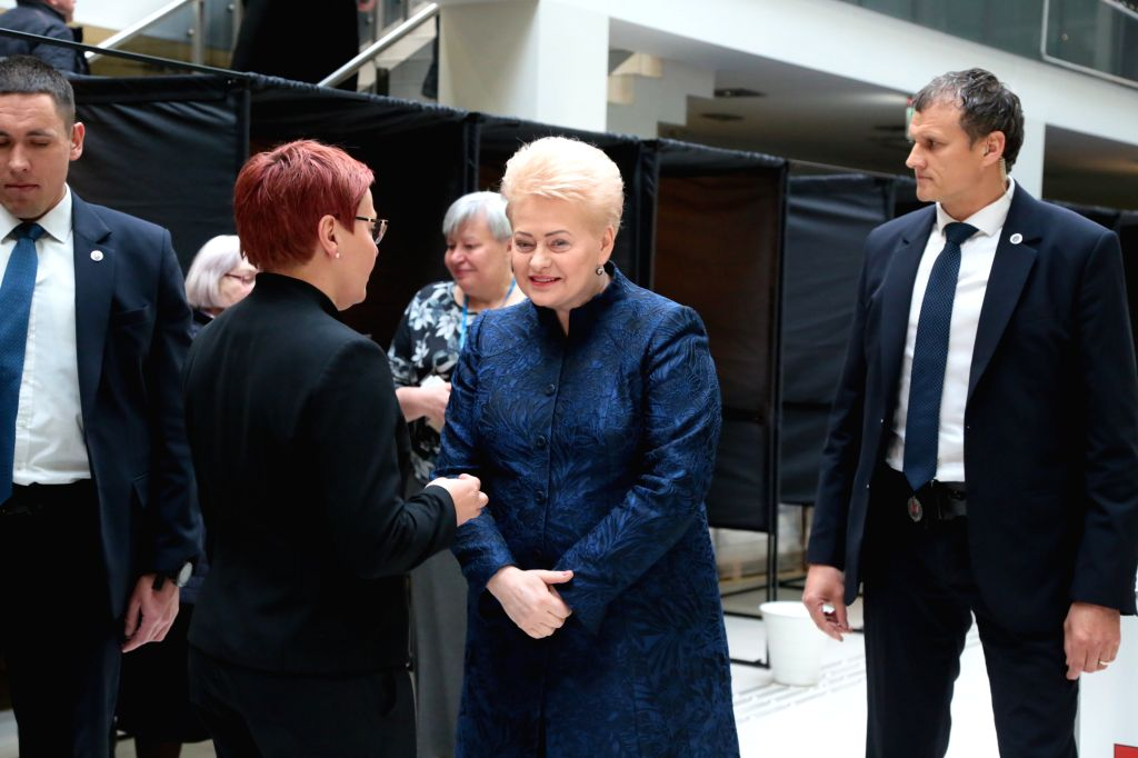 VILNIUS, May 7, 2019 (Xinhua) -- Lithuanian President Dalia Grybauskaite (2nd R) talks with a staff member of the polling station after casting her vote in the presidential elections and the dual citizenship referendum in Vilnius, Lithuania, May 7, 2