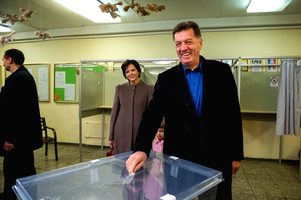 VILNIUS, Oct. 23, 2016 - Lithuanian Prime Minister Algirdas Butkevicius (R) casts his ballot in a polling station for the parliament election in Vilnius, Lithuania, Oct. 23, 2016. Lithuania is ... - Algirdas Butkevicius