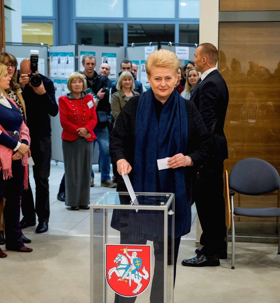 VILNIUS, Oct. 5, 2016 - Lithuanian President Dalia Grybauskaite (C) casts her vote in the parliament election in Vilnius, Lithuania, Oct. 5, 2016. Lithuanian President Dalia Grybauskaite voted in an ...