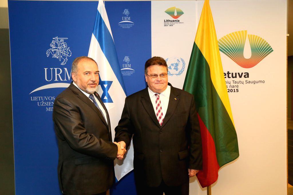 Israel's foreign minister Avigdor Liberman (L) and Lithuania's foreign minister Linas Linkevicius shake hands prior to a joint press conference in Vilnius, ...