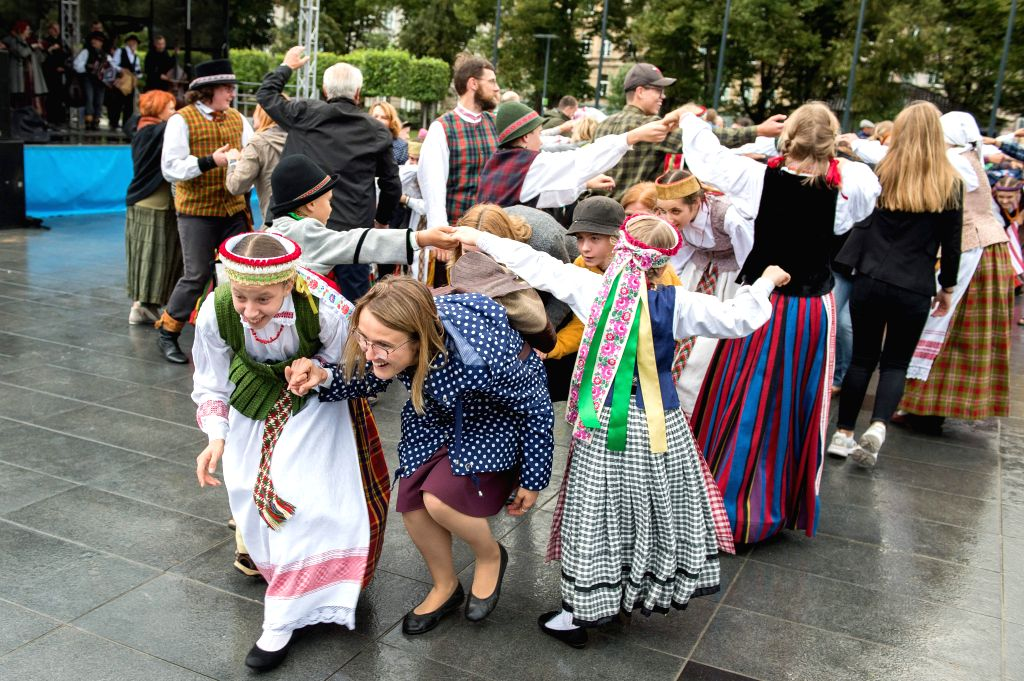 VILNIUS, Sept. 13, 2019 - Visitors join a dance with performers at a traditional Nations' Fair in Vilnius, Lithuania, on Sept. 13, 2019. The Nations' Fair opened in Vilnius on Friday, hosting around ...