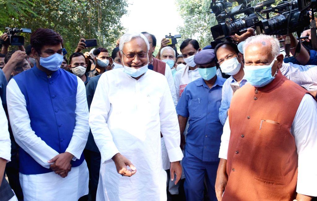 VIP Party chief Mukesh Sahani, Bihar Chief Minister and JD-U National President Nitish Kumar and HAM-S chief Jitan Ram Manjhi leave after attending NDA meeting in Patna, on Nov 13, 2020. - Nitish Kumar