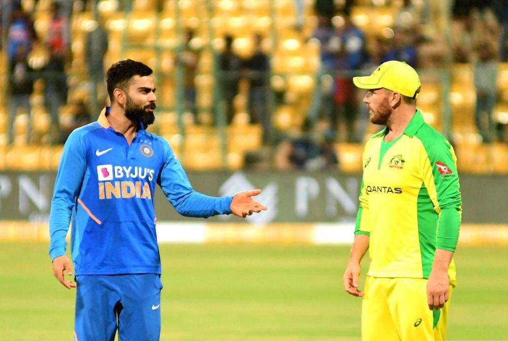 Virat Kohli and Aaron Finch. (Photo: Surjeet Yadav/IANS) - Virat Kohli and Surjeet Yadav