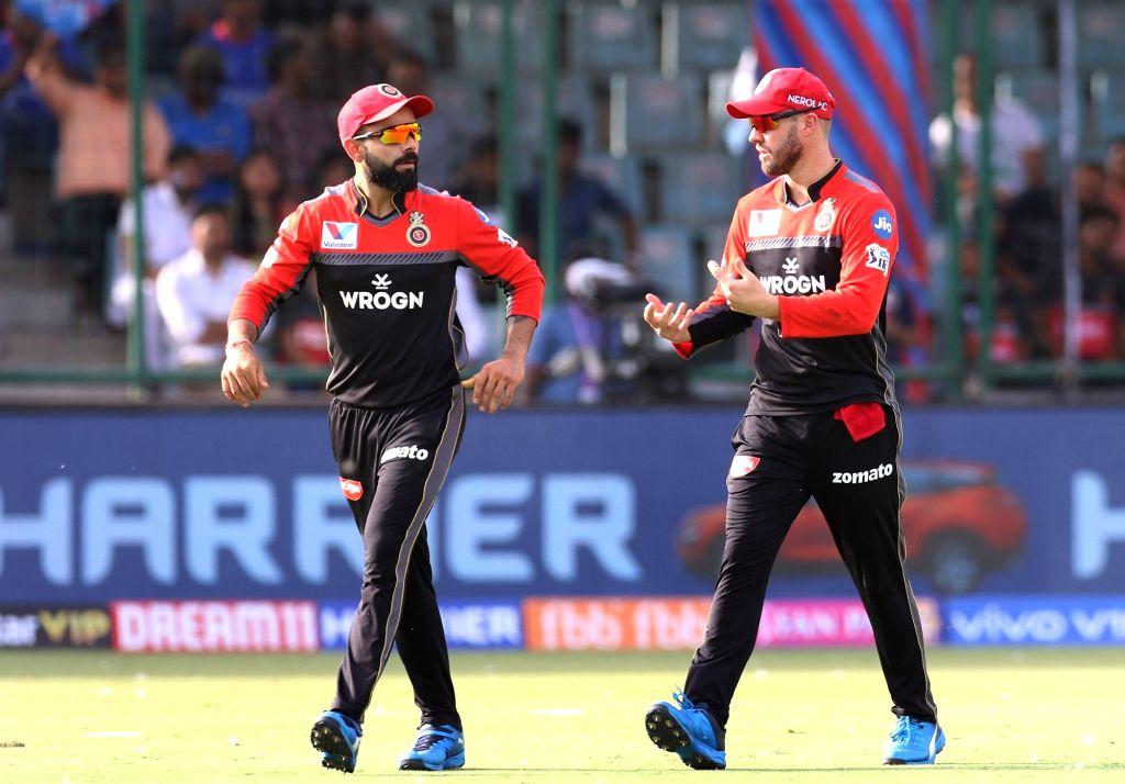 Virat Kohli and AB de Villiers. (Photo: Surjeet Yadav/IANS) - Virat Kohli and Surjeet Yadav