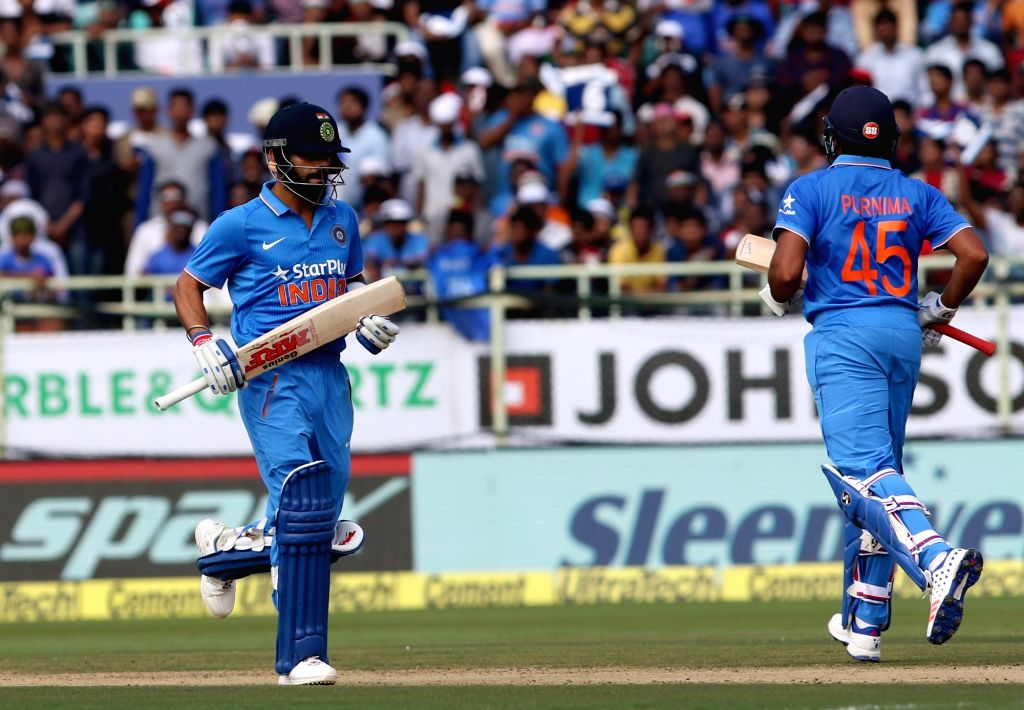 Virat Kohli and Rohit Sharma of India in action during the fifth ODI match between India and New Zealand at Dr. Y.S. Rajasekhara Reddy ACA-VDCA Cricket Stadium in Visakhapatnam on Oct ... - Virat Kohli and Rohit Sharma