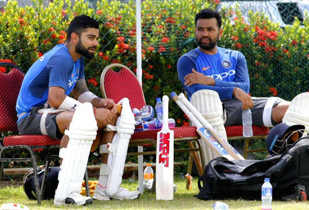 Virat Kohli and Rohit Sharma. (Photo: Surjeet Yadav/IANS) - Virat Kohli, Rohit Sharma and Surjeet Yadav