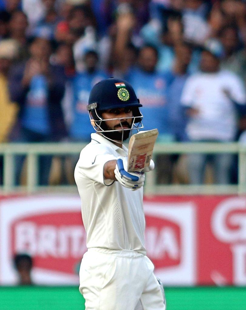 Virat Kohli captain of India celebrates his half century during day three of the 2nd test match between India and England at the Dr. Y.S. Rajasekhara Reddy ACA-VDCA Cricket Stadium in ... - Virat Kohli
