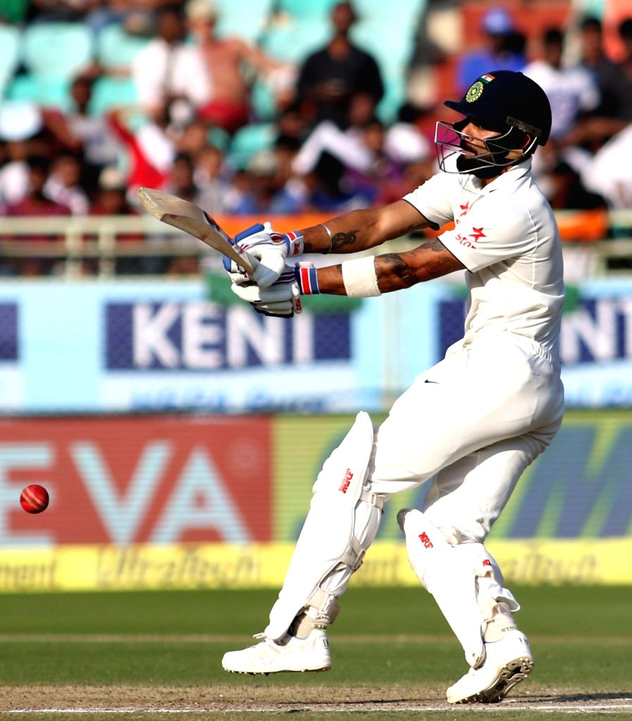 Virat Kohli Captain of India plays a shot during day three of the 2nd test match between India and England at the Dr. Y.S. Rajasekhara Reddy ACA-VDCA Cricket Stadium in Visakhapatnam ... - Virat Kohli Captain