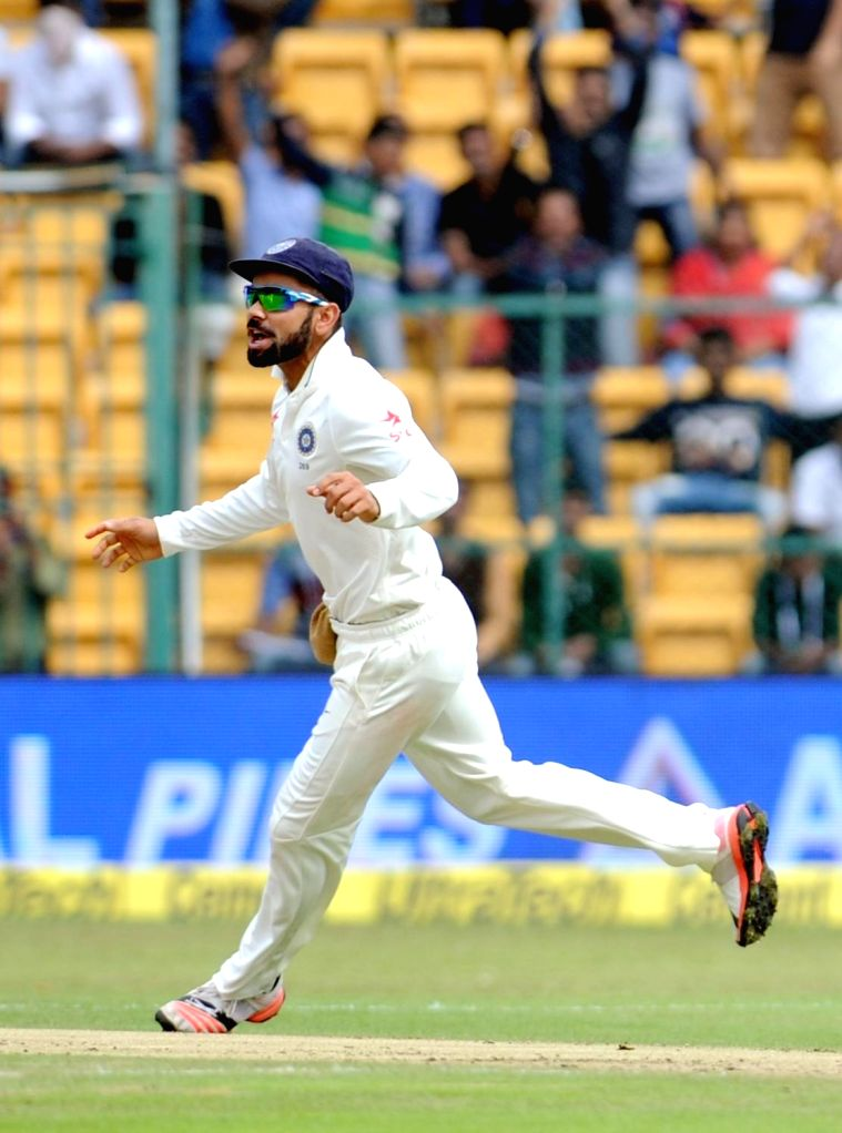 Virat Kohli celebrates fall of a wicket during the first day of the second test match between India and South Africa at M Chinnaswamy Stadium in Bengaluru, on Nov 14, 2015. - Virat Kohli