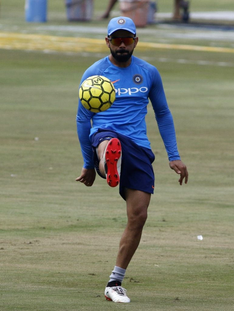 Virat Kohli in action during a practice session ahead of the 3rd T20 match against Australia at the Rajiv Gandhi International Cricket Stadium in Hyderabad on Oct 12, 2017. (Photo: Surjeet ... - Virat Kohli and Surjeet Yadav