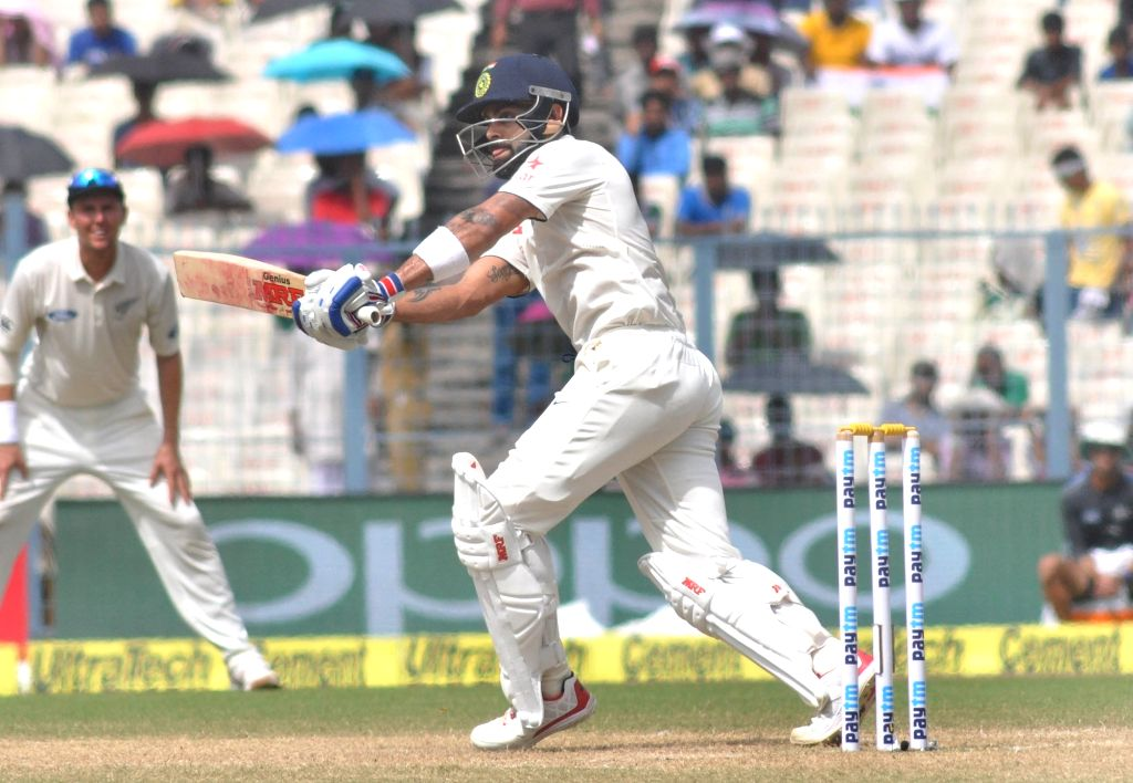 Virat Kohli in action on the third day of the Second Test Match between India and New Zealand at Eden Gardens in Kolkata on Oct 2, 2016. - Virat Kohli