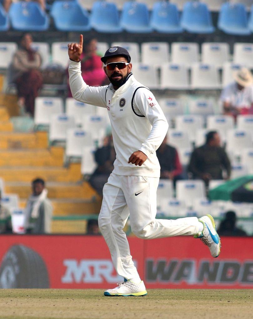 Virat Kohli  of India celebrates fall of Jos Buttler's wicket on Day 4 of the third test match between India and England at Punjab Cricket Association IS Bindra Stadium, Mohali on Nov 29, ... - Virat Kohli