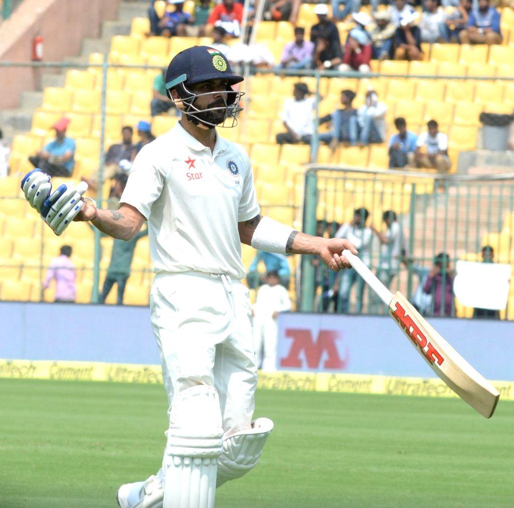 Virat Kohli of India during the third day of the second test match between India and Australia at M. Chinnaswamy Stadium in Bengaluru on March 6, 2017. (Photo: IANS) - Virat Kohli