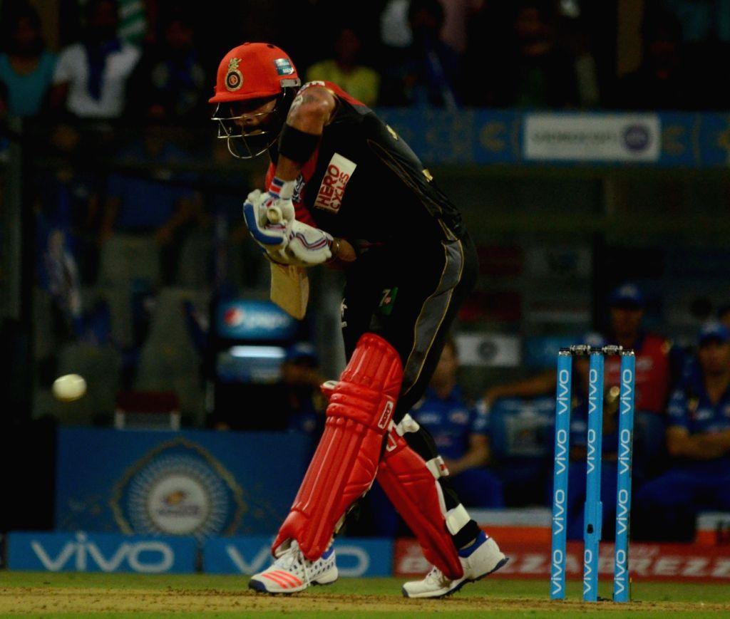 Virat Kohli of Royal Challengers Bangalore in action during IPL match between  Mumbai Indians and Royal Challengers Bangalore at Wankhede Stadium in Mumbai on April 20, 2016. - Virat Kohli