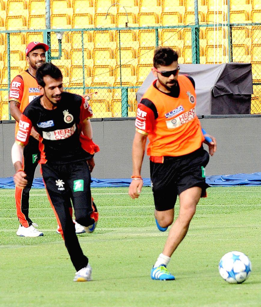 Virat Kohli of Royal Challengers Bangalore in action during a practice session at M Chinnaswamy Stadium in Bengaluru, on May 27, 2016. - Virat Kohli