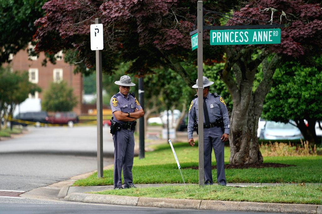VIRGINIA BEACH (U.S.), June 1, 2019 Photo taken on June 1, 2019 shows police officers on duty near the Municipal Center buildings where a mass shooting occurred in Virginia Beach, ...