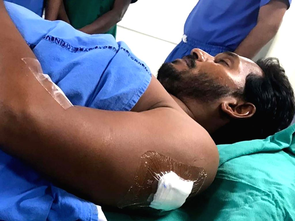 :Visakhapatam: YSR Congress Party President Y.S. Jaganmohan Reddy at City Neuro Hospital after he was attacked with a knife by a young man who, according to the police, sneaked up to him with a ...
