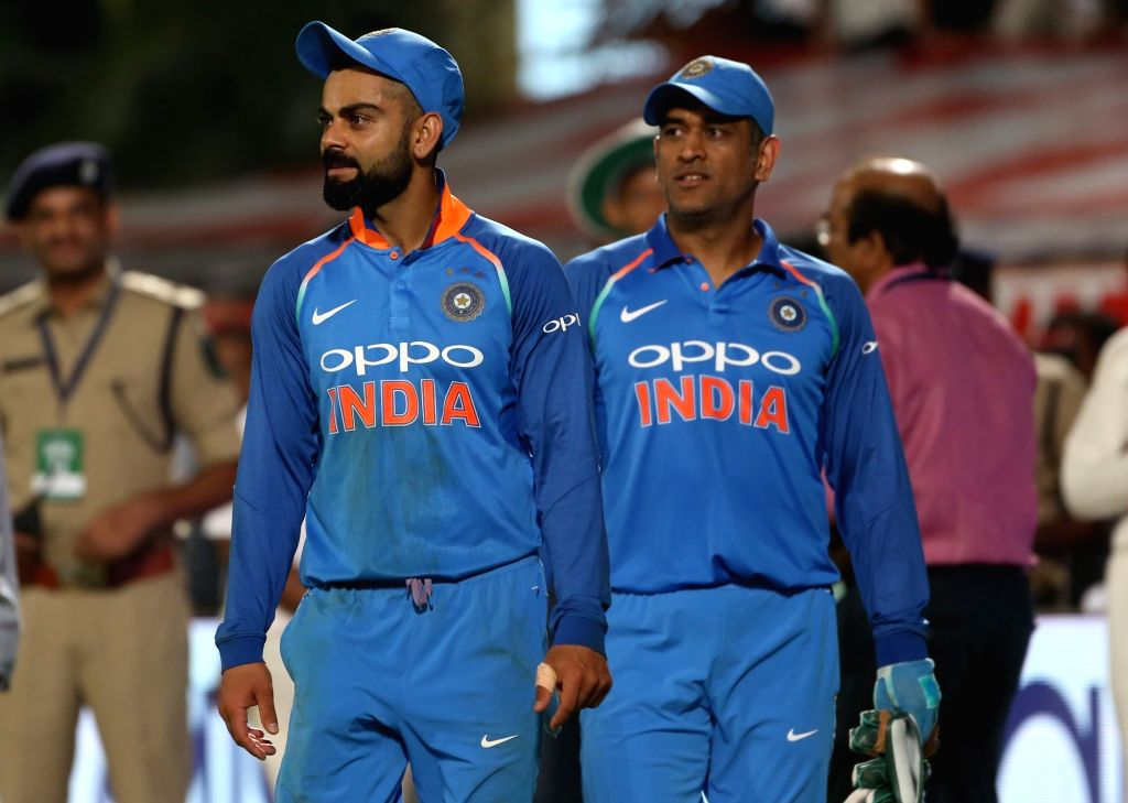 Visakhapatnam: India's Virat Kohli and MS Dhoni after the second ODI (One Day International) match between India and West Indies that ended in a tie at Dr. Y.S. Rajasekhara Reddy ACA-VDCA Cricket Stadium in Visakhapatnam, on Oct 24, 2018. (Photo: Sur - MS Dhoni, Virat Kohli and Surjeet Yadav