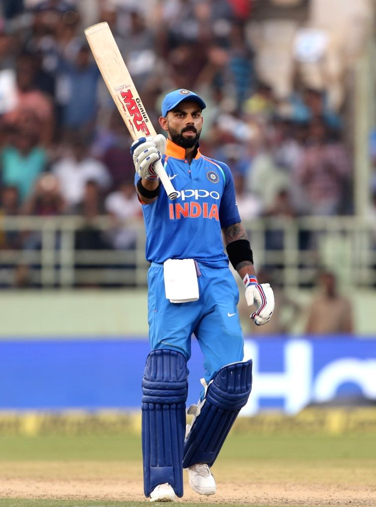 : Visakhapatnam: Indian captain Virat Kohli celebrates his century during the second ODI match between India and West Indies at Dr. Y.S. Rajasekhara Reddy ACA-VDCA Cricket Stadium in Visakhapatnam, ...