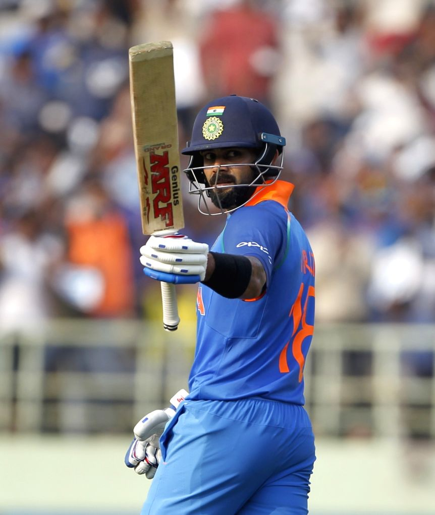 : Visakhapatnam: Indian captain Virat Kohli celebrates his half century during the second ODI match between India and West Indies at Dr. Y.S. Rajasekhara Reddy ACA-VDCA Cricket Stadium in ...