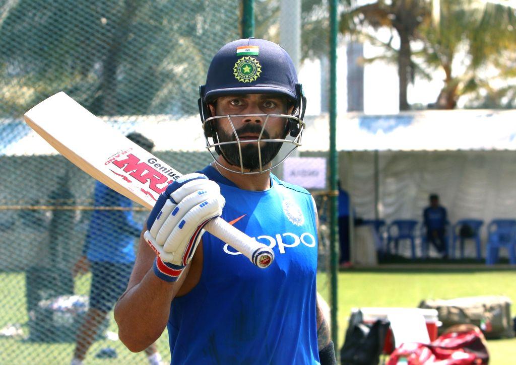 Visakhapatnam: Indian captain Virat Kohli during a practice session ahead of the 1st T20I match against Australia at ACA-VDCA Cricket Stadium in Visakhapatnam on Feb 23, 2019. (Photo: Surjeet Yadav/IANS) - Virat Kohli and Surjeet Yadav