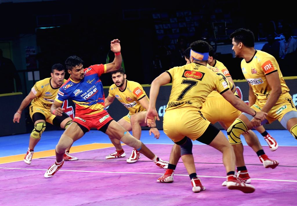 : Visakhapatnam: Players in action during a Pro Kabaddi 2018 match between Telugu Titans and UP Yoddha at Rajiv Gandhi Indoor Stadium in Visakhapatnam on Dec 11, 2018. (Photo: IANS).
