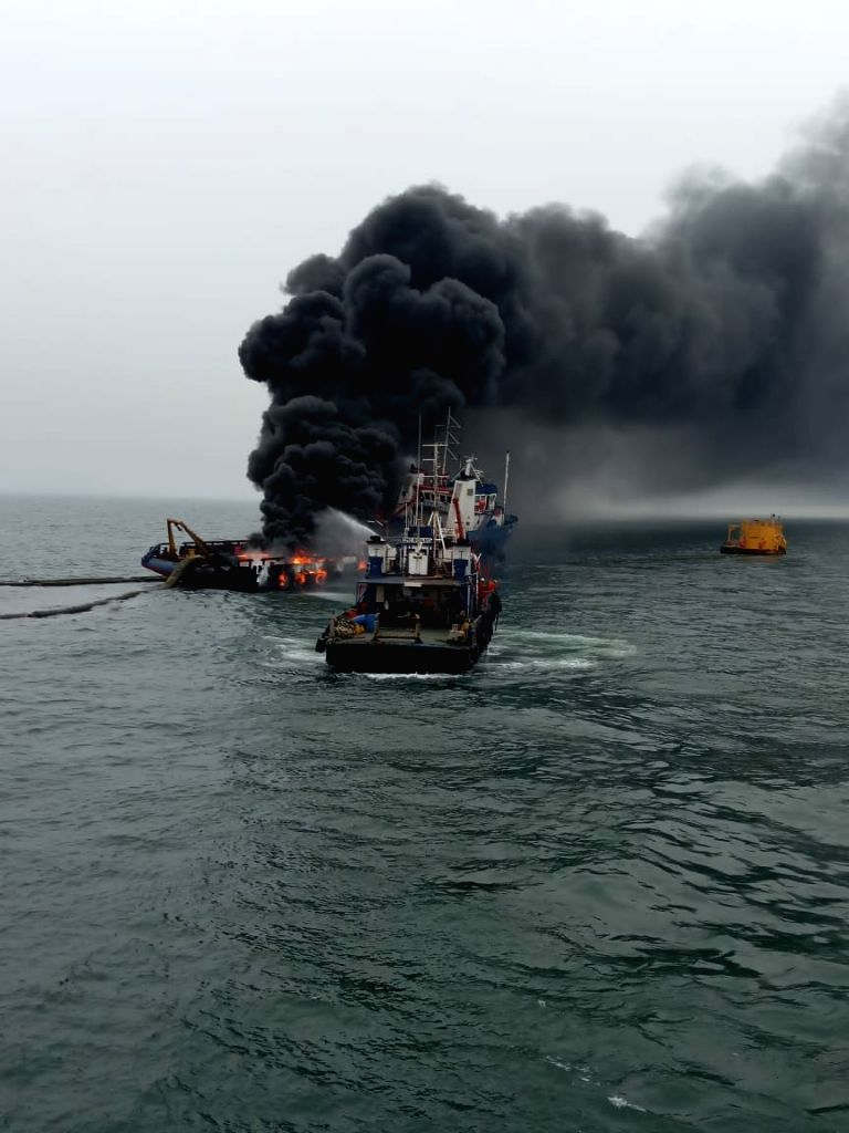 Visakhapatnam: Rescue operation underway after a major fire broke out on an offshore support vessel off Visakhapatnam coast; on Aug 12, 2019. Reportedly one crew member of Coast Guard was missing while 28 were rescued. (Photo: IANS)