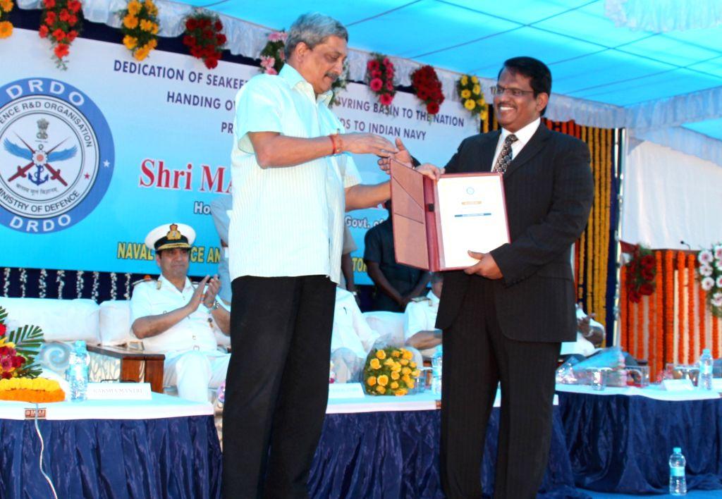 :Visakhapatnam: Union Minister for Defence Manohar Parrikar presents the National Award to the Secretary Dept. of Defence RD and Director General of DRDO, Dr. S. Christopher, at Visakhapatnam on ... - Manohar Parrikar