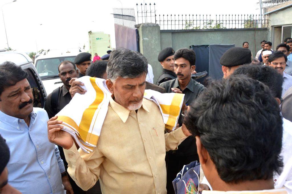 Andhra Pradesh Chief Minister N. Chandrababu Naidu arrives at Vishakahapattanam airport on Dec 17, 2014. - N. Chandrababu Naidu