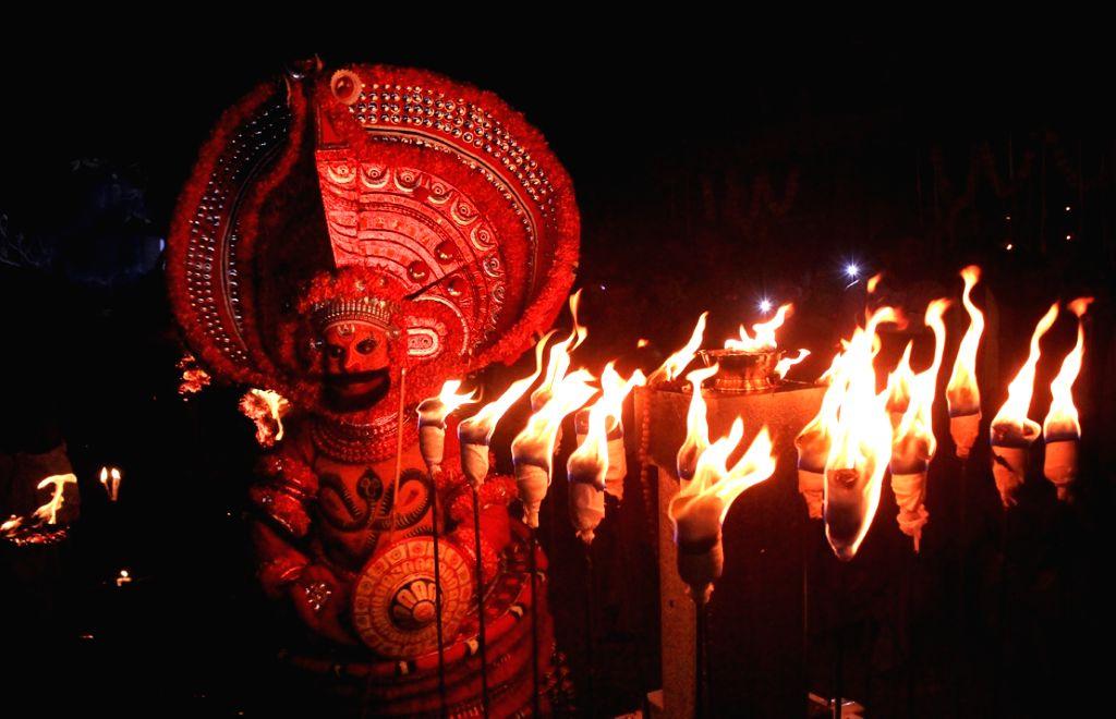 "Vishakandan Theyyam""  celebrations underway at Chatham Pallikavu at Kolachery in Kannur to mark the beginning of the Theyyam season in North Malabar on Oct 26, 2016."
