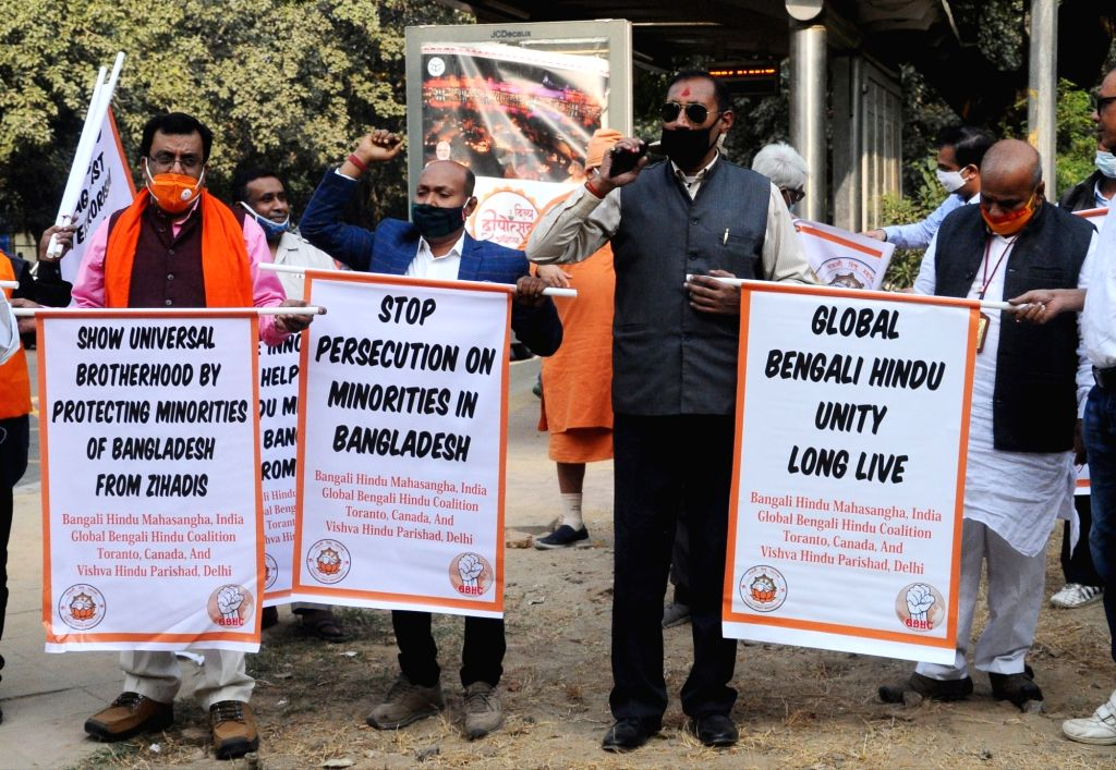 Vishwa Hindu Parishad (VHP) workers led by its International Secretary Prashant Hartalkar protest against attacks on the Hindu community and forceful religious conversions in Bangladesh, ...