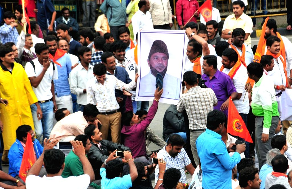 Vishwa Hindu Parishad volunteers along with BJP workers stage a demonstration against death of one of the VHP leader in demonstrations against the birth anniversary celebrations of Tipu ...