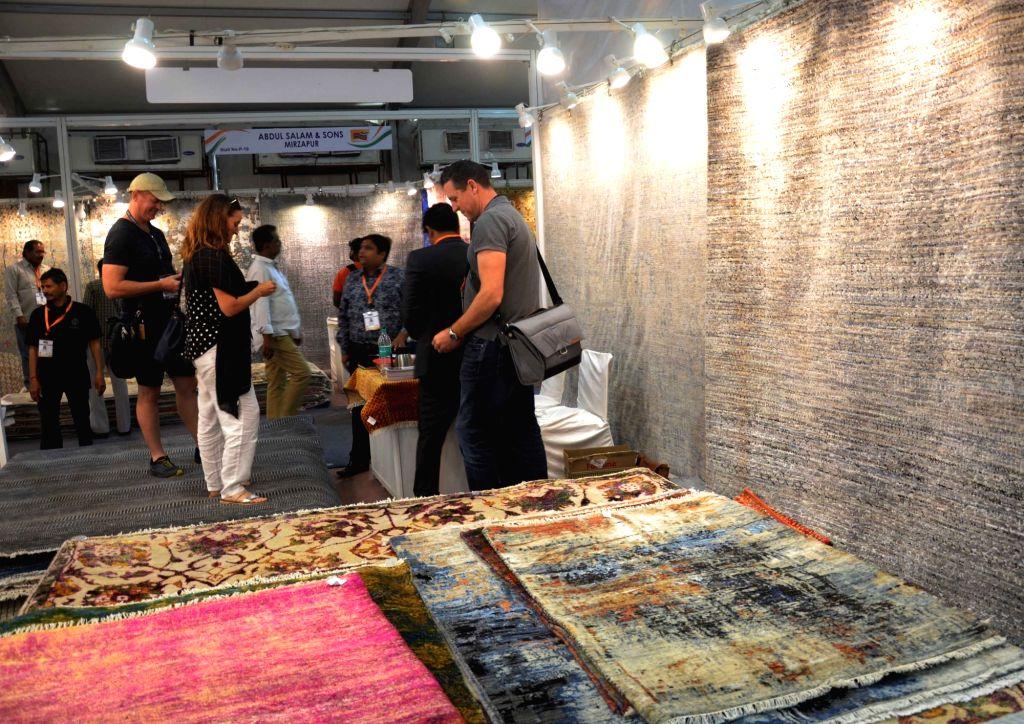 Visitors at 34th India Carpet Expo in Varanasi, on Oct 12, 2017.