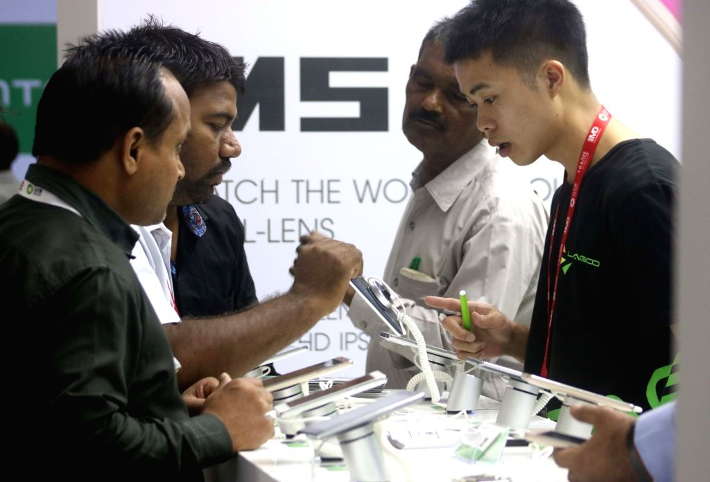 Visitors at Mobile fair at Pragati Maidan in New Delhi on Oct 22, 2016.
