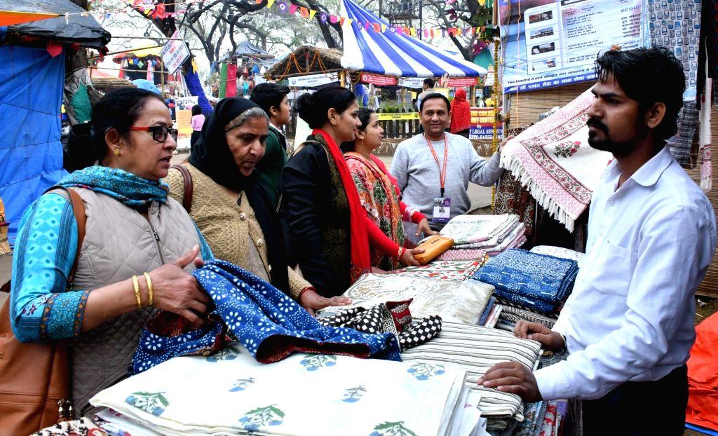 Visitors at the 33rd Surajkund International Crafts Mela, in Faridabad, on Feb 14, 2019.